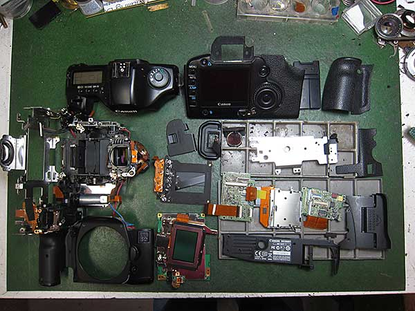 A Canon 5D disassembled for repairs.