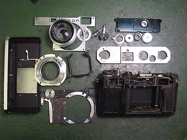 A Nikon S disassembled for repairs.